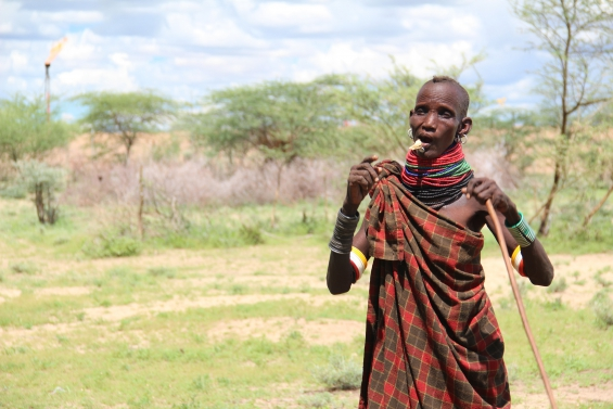 Turkana herder by gas flare